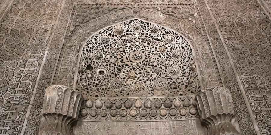 Fig. 1: Orumiyeh Friday mosque in North-Western                         Iran (Seljuk mosque and Ilkhanid stucco revetment). Detail of whitewashed                         stucco mihrab. (© Grbanovic 2014)